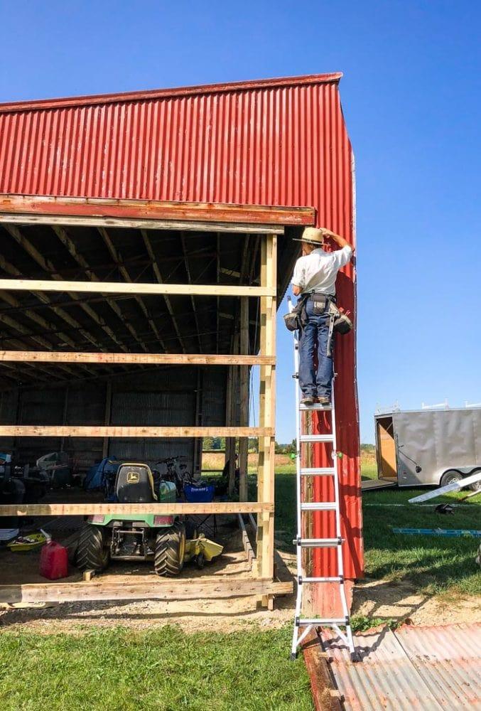 amish working on barn