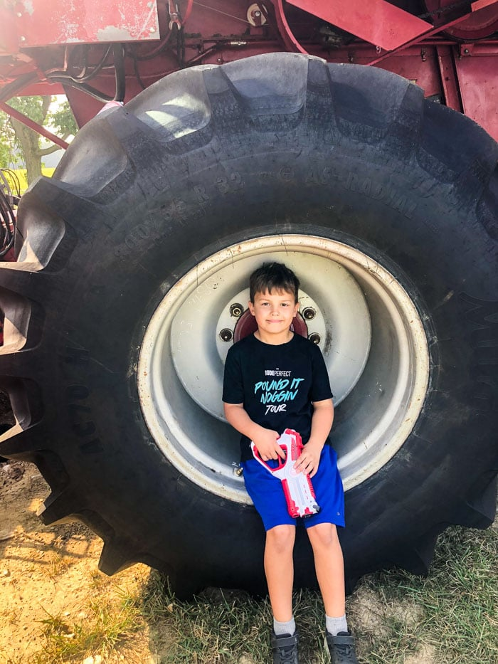 boy in large tractor tire
