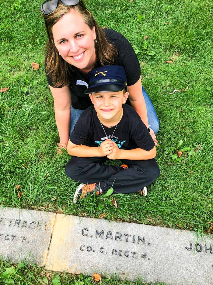 family in front of Gettysburg grave