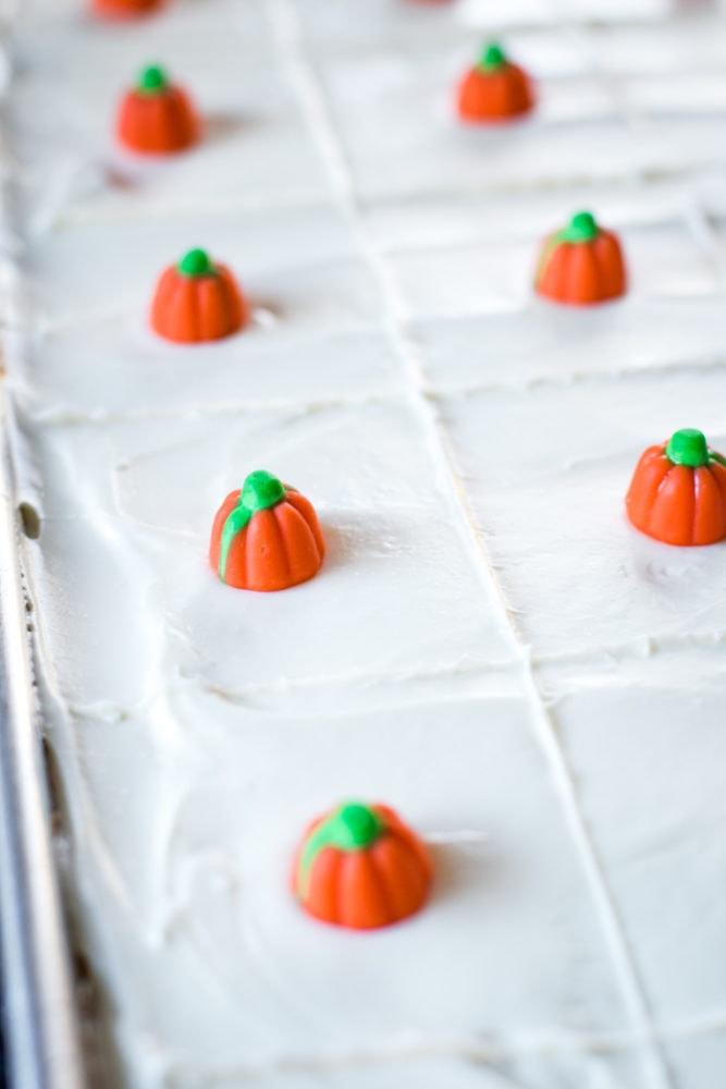 candied pumpkins on pumpkin cake bars