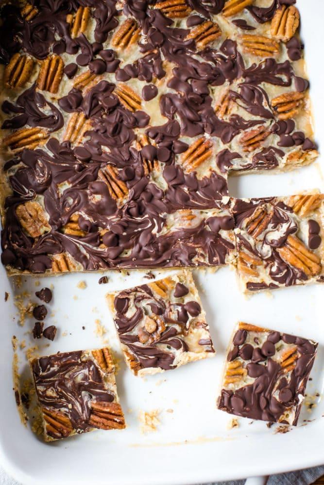 turtle cookie bars in baking pan
