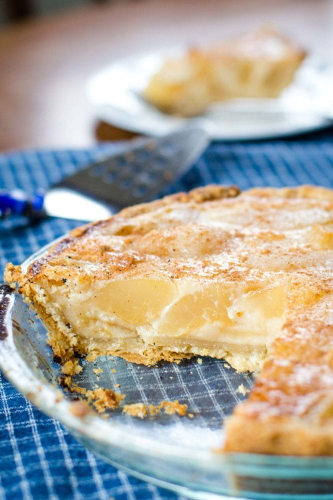custard pear pie with slice out of it