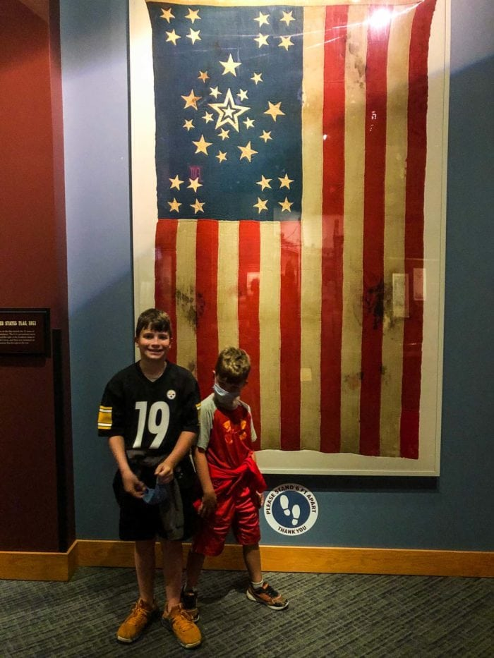boys in front of flag