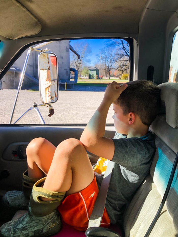 boy in farm truck