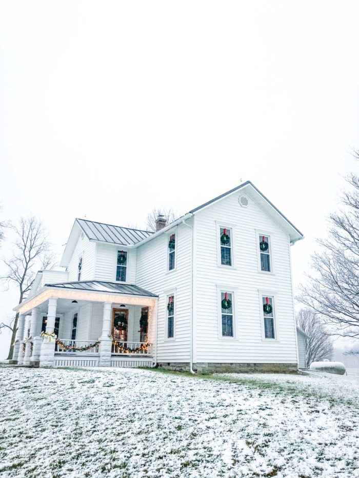white farmhouse with dusting of snow