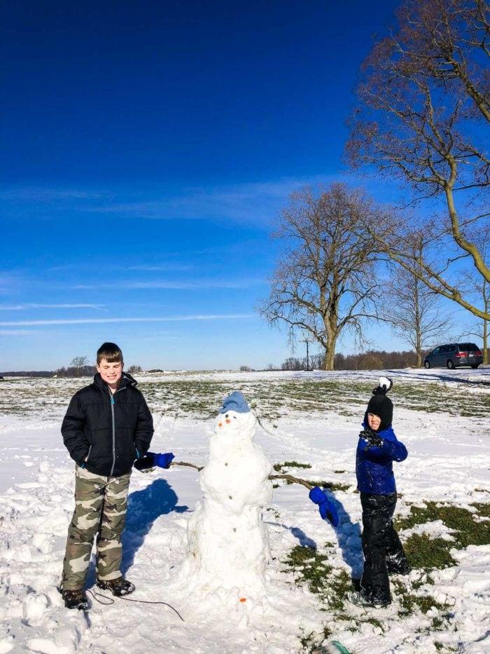 boys with snowman