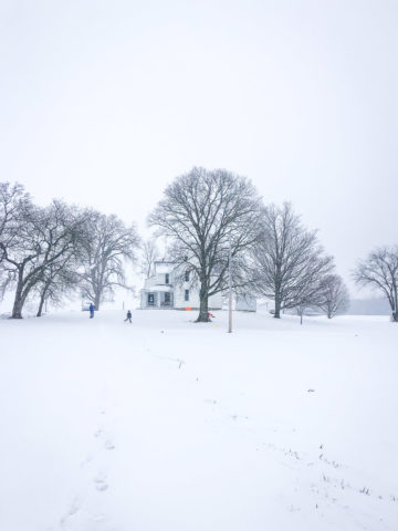 farmhouse with snow