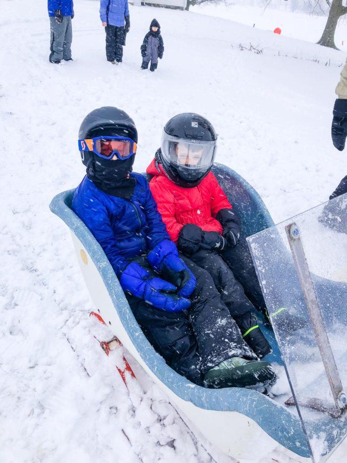 kids on snow mobile