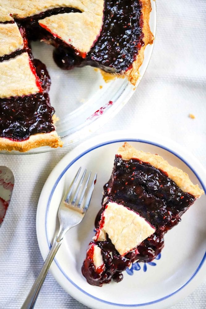 slice of mixed berry pie on plate with fork