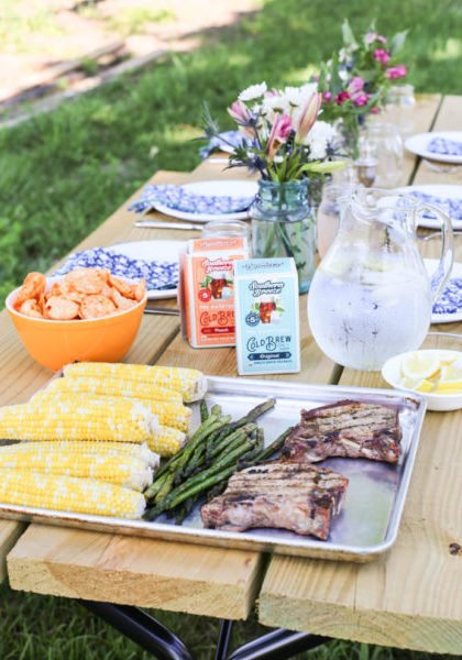 picnic table with grilled vegetables and meat